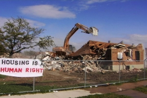 New-Orleans-home-demolition-sign-Housing-is-a-Human-Right1